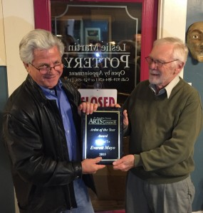 Everett Mayo receives Artist of the Year plaque from Billy Farmer.