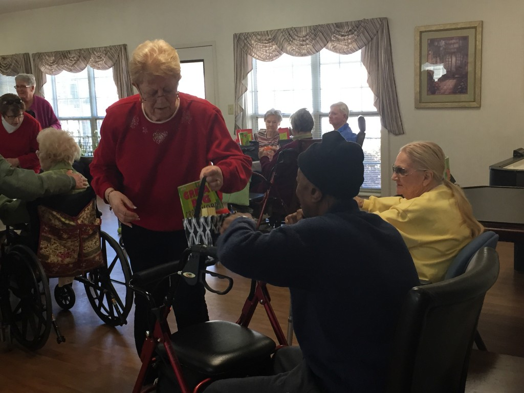 Pat Kendrick talking with residents at the Zebulon House Valentine event. Photo: Kay Whatley, greyareanews.com