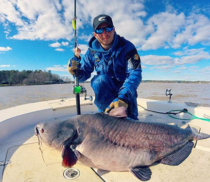 Zakk Royce, with a 100-pound catfish he recently caught. Photo Source ncwildlife.org.