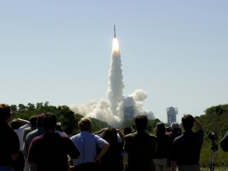 At 11:02 a.m. EDT on April 7, 2001, crowds watch a Boeing Delta II rocket lift off from Cape Canaveral Air Force Station, Florida, carrying NASA's 2001 Mars Odyssey spacecraft into space on its seven-month journey to Mars. Photo: NASA/JPL-Caltech/Arizona State University.