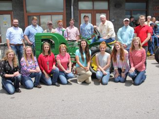 Agriculture Commissioner Steve Troxler, back row, third from right, meets with 16 of the 27 recipients of the 2016 N.C. State Fair Youth Livestock Scholarships at the Got to Be NC Festival. Source: NCDA&CS, Raleigh NC.