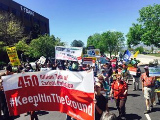 """Protesters tell President Obama to """"Keep it in the Ground"""" at a federal fossil fuel lease auction in Lakewood, Colo. Photo by Taylor McKinnon, Center for Biological Diversity."""