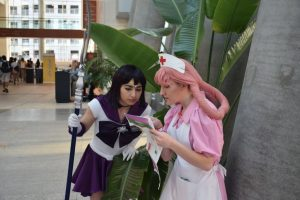 Two participants check what's coming up at the 2016 Animazement in Raleigh NC. Photo: Mitch Amiano.