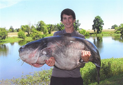 Benson angler Landon Evans, 15, holds the new state record for blue catfish - a 117-pound, 8 ounce fish, caught from Lake Gaston on June 11, 2016. Source: Landon Evans.