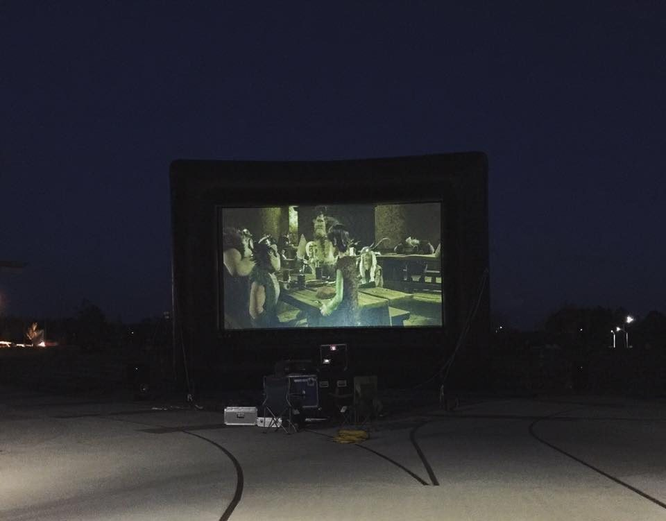 It takes lots of equipment to show an outdoor movie. Setup is done by Traveling Screens. Source: Thomas Walls and Megan Thornton, knightdalenc.gov.
