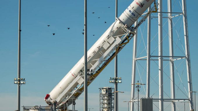 The Orbital ATK Antares rocket, with the Cygnus spacecraft onboard, is raised into the vertical position on launch Pad-0A, Friday, October 14, 2016, at NASA's Wallops Flight Facility in Virginia. Photo Credit: NASA/Bill Ingalls.