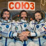 At the Integration Facility at the Baikonur Cosmodrome in Kazakhstan, Expedition 49 crewmembers Shane Kimbrough of NASA (left) and Sergey Ryzhikov (center) and Andrey Borisenko (right) of Roscosmos pose for pictures Sept. 9, 2016, in front of their Soyuz MS-02 spacecraft during a pre-launch training fit check. Kimbrough, Ryzhikov and Borisenko will launch on the Soyuz MS-02 vehicle for a five-month mission on the International Space Station. Source: NASA/Victor Zelentsov.