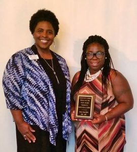 Mrs. Epps receives an award from the Rocky Mount Business and Professional Womens Club.