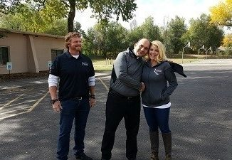 Father Andre and Interstate Roofing representative. Source: Interstate Roofing, Denver CO.