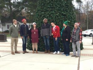 Group singing Christmas Carols at Rudolph's Food Truck Rodeo. Photo: Kay Whatley.