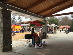 Vendors and bounce houses at Knightdale Station Park during Rudolph's Food Truck Rodeo. Photo: Kay Whatley.