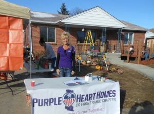 Purple Heart Homes Front Range Colorado Chapter President Diana Fleming involves volunteers to build a wheelchair accessible ramp, installed a new front door, widened a bathroom and bathroom door for Vietnam Veteran Arthur Mayfield, an above the knee amputee. Source: PHH.