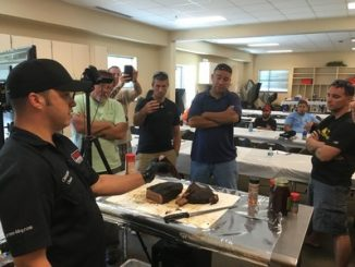 During a recent Wounded Warrior Project(R) (WWP) connection event at Prime Barbecue, a specialty catering service that also offers barbecue preparation classes, injured veterans talked grilling and received trade secrets from an expert. Source: WWP.