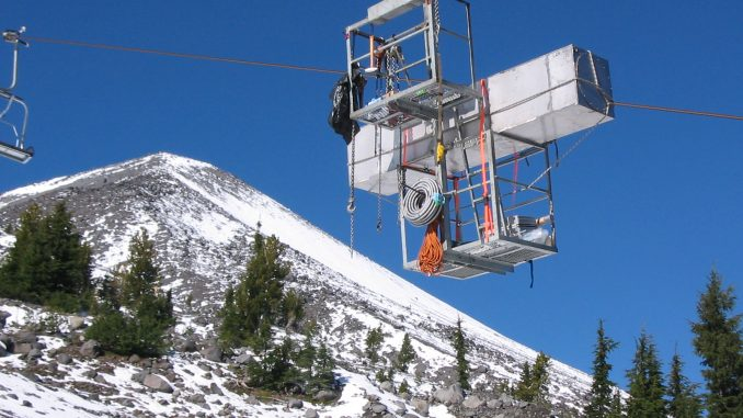 Researchers use ski lifts to carry equipment to sample air on the summit of Mount Bachelor. In this image, a radon sensor travels to the peak. Credit: Dan Jaffe/University of Washington Bothell.