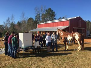 Kim Haselhuhn of Kindred Spirits Farm, Zebulon NC, leads an educational session with students from East Wake Academy. Photo: Kay Whatley