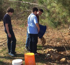 EWA students cleared rocks from pasture, added to fire pit area. Photo: Kay Whatley