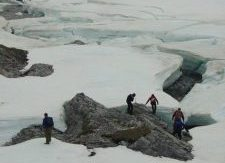 A river icing on a small unnamed river that drains into Galbraith Lake, Alaska, which is in the Atigun River basin and was a major base camp location for the construction of the Trans-Alaska Pipeline connecting the Arctic Ocean to Valdez, Alaska. The people in this photo are researchers and students associated with Toolik Field Station. Credit: Jay Zarnetske.