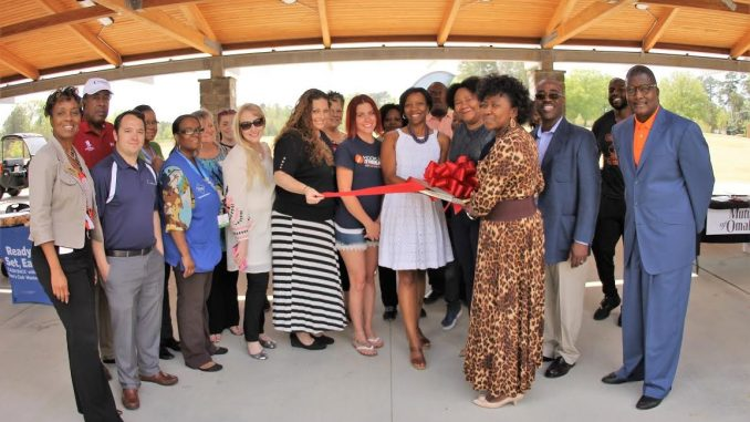 Knightdale Chamber Members gathered centrally to cut one ceremonial ribbon at the April 2017 Red Ribbon Showcase. Source: Patrice Bayyan.