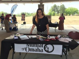 Mutual of Omaha rep Robbi Laney at her Red Ribbon Showcase table. Photo: Kay Whatley.
