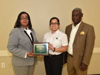 Miriam Espinosa (middle), environmental leader with Cummins-Rocky Mount Engine Plant and KAB Advisory Board member, accepted the Sponsor of the Year Award on the company's behalf. Pictured (l-r) Cornelia McGee, Espinosa and James Alston, KAB Advisory Board chairman. Source: City of Rocky Mount NC.