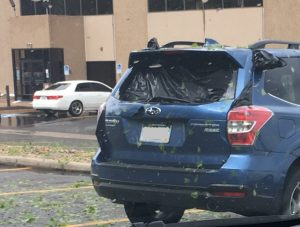 Shattered vehicle window from Denver, Colorado hail storm May 8, 2017. Source: N. Banks.