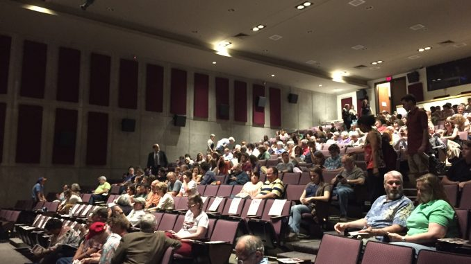"""Audience taking their seats for """"Homeplace Under Fire"""" screening, Griffith Film Theatre, Duke University, Durham NC. Photo: Kay Whatley."""