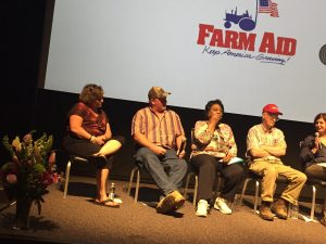 Flowers in honor of Lou Anne Kling on stage, next to panel members Valerie Byrum, Curtis Byrum, Shirley Sherrod, Benny Bunting, and Jennifer Fahy at the May 18, 2017 screening. Photo: Kay Whatley.