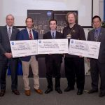 Three teams earned a $20,000 prize check and a slot to launch their CubeSat on Exploration Mission-1, the first integrated flight of NASA's Space Launch System. NASA's Associate Administrator of the Space Technology Mission Directorate, Steve Jurczyk, Benjamin Fried of team CU-E3, Kyle Doyle of team Cislunar Explorers, Wesley Faler of Team Miles, and NASA's Ames Research Center Director, Eugene Tu. Credits: NASA/Dominic Hart.