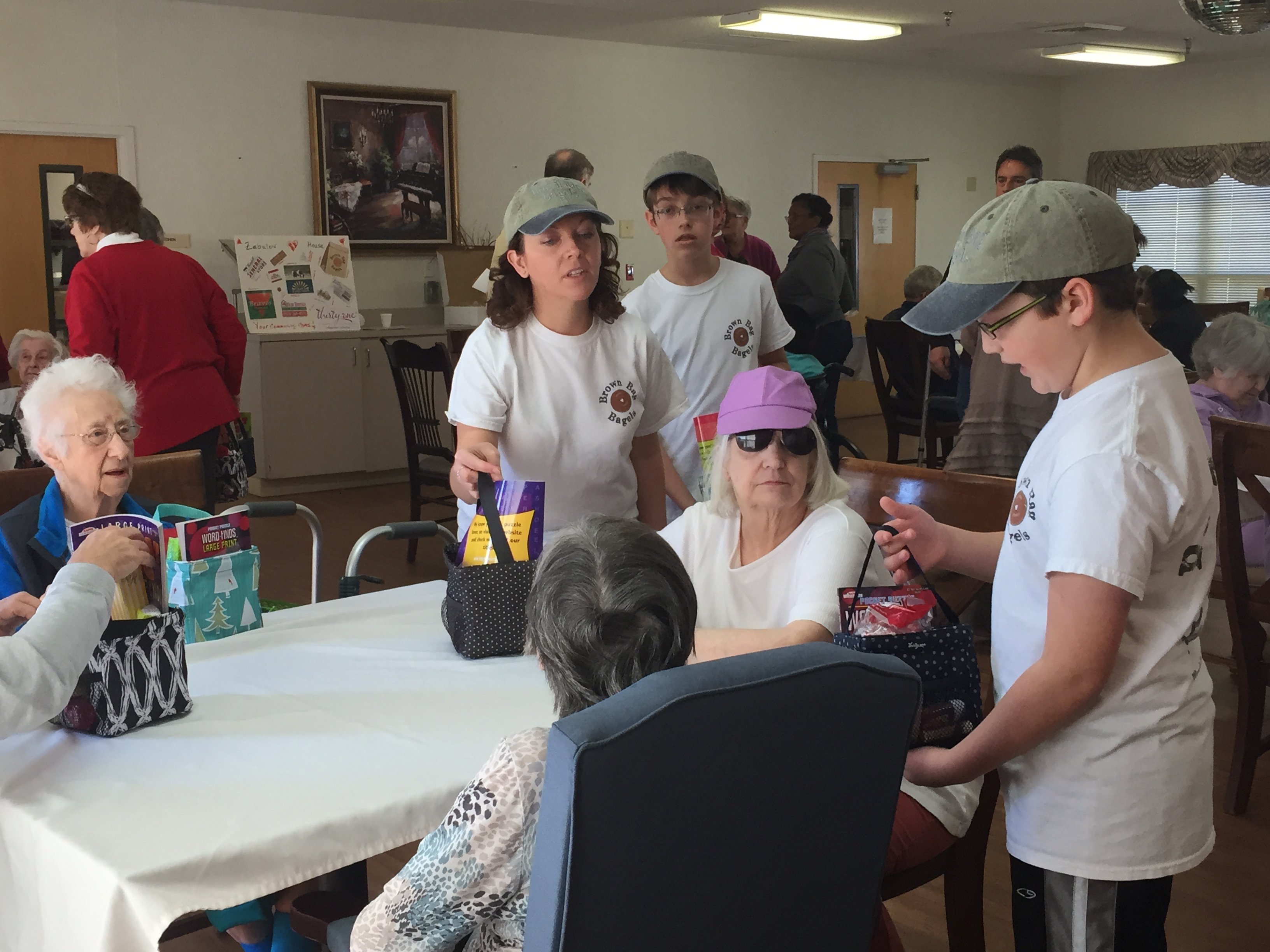 The Brown Bag Bagels family, volunteering recently at a local nursing home. Photo: Kay Whatley.