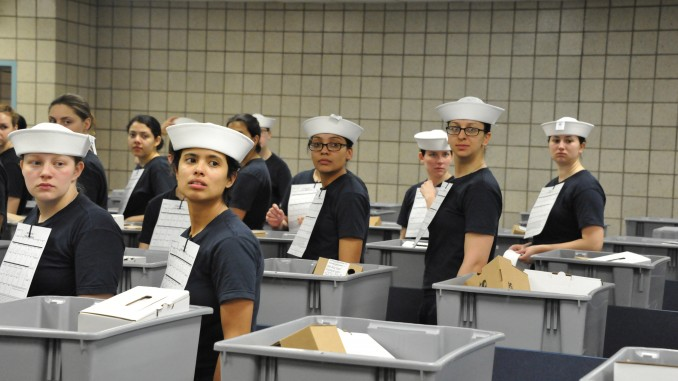 """April 4, 2016 - Female seaman recruits receive their white enlisted hats, or """"Dixie Cups,"""" during uniform issue at Recruit Training Command. These women were among the first recruits to be issued the Dixie cup as part of the Navy's efforts for uniformity in service members' uniforms. (US Navy photo by Sue Krawczyk/Released)."""