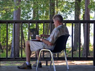 Bill Cokas found a quiet spot on the porch for writing during the retreat. Photo: Jackie Dove-Miller, Louisburg NC.