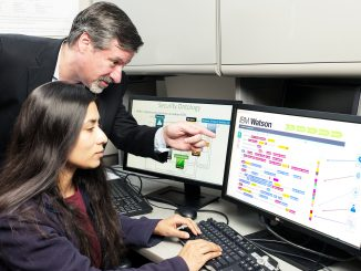 IBM's Chief Watson Security Architect Jeb Linton demonstrating to University of Maryland Baltimore County student Lisa Mathews how to teach IBM's Watson the language of security, May 10, 2016, Baltimore, MD. Source: IBM.