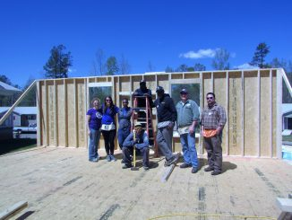 Wounded veterans build a wall during service project. Source: PRNewsFoto/Wounded Warrior Project.