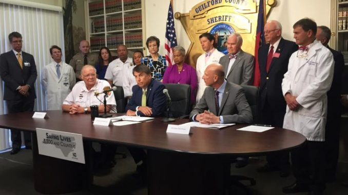 Naloxone signing, Greensboro NC. Source: NC Office of the Governor.