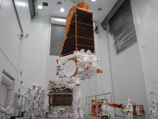Kepler before launch. At the Hazardous Processing Facility at Astrotech in Titusville, Florida, workers guide the suspended Kepler spacecraft onto a Delta II third stage. Photo: NASA/Troy Cryder February 16, 2009.
