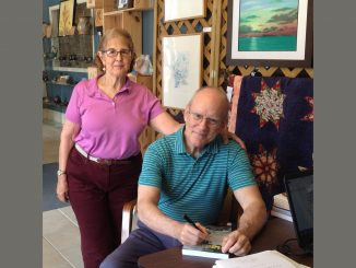 Author Bob McCarthy and his wife, Sue, signing a book at UpFront Gallery (FCAC) in Franklinton, North Carolina.