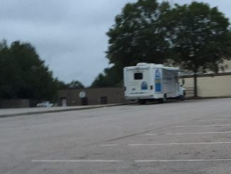 SNAP-NC mobile veterinary clinics travel to make spaying and neutering more accessible. This is a SNAP van in a Zebulon NC store parking lot. Photo: Kay Whatley.