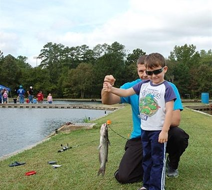 Skylar Johnston of Fayetteville reeled in his first catch ever - a channel catfish - while fishing during the 2014 Wildlife Expo at the John E. Pechmann Fishing Education Center in Fayetteville. Fishing is one of several activities offered at the Wildlife Expo this year. Source: ncwildlife.org.