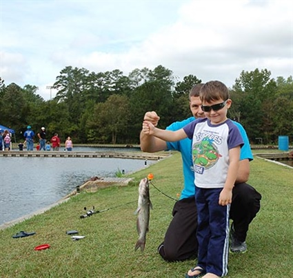 Skylar johnston of fayetteville reeled in his first catch for Fishing in fayetteville nc