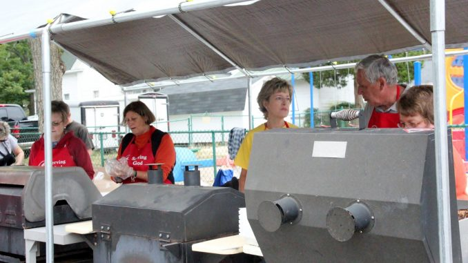 Serving food and serving God: volunteers at the 2015 Fall Festival. Source: Zebulon United Methodist Church, Zebulon NC.