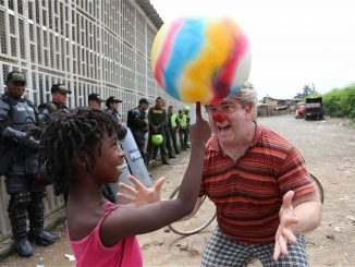 In Colombia, a clown troupe visits a rural village that was scheduled to be razed. Peaceful intervention efforts, like the spinning ball trick, lowered tensions and opened dialogue between the villagers and police. Source: PRNewsFoto/Clowns Without Borders USA.
