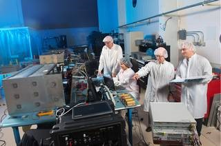 Glenn scientists test Saffire components. Credit: NASA.
