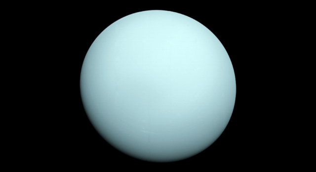 Arriving at Uranus in 1986, Voyager 2 observed a bluish orb with extremely subtle features. A haze layer hid most of the planet's cloud features from view. Credit: NASA/JPL-Caltech.