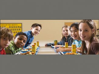 Students eating lunch in cafeteria. Source: Food and Nutrition Services, USDA.
