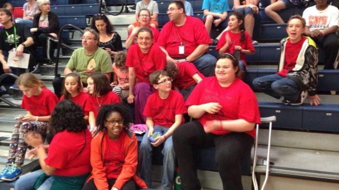 Coach Jeffrey Hagman with the kids. Source: Mary DeMilia