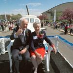 John and Annie Glenn ride a float in a parade at the NASA's Glenn Research Center. In 1999, NASA Lewis was renamed the NASA John H. Glenn Research Center at Lewis Field in Glenn's honor. The parade was one of many festivities that celebrated the name change. Source: Frank Jennings.