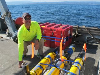 JPL's Steve Chien with several of the underwater drones used in a research project earlier this year. Image: NASA/JPL-Caltech.