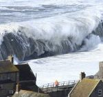 Extreme waves crashing on Chesil Beach in Dorset in southern England on February 5, 2014. A new study finds find global warming could cause extreme sea levels to increase significantly along Europe's coasts by 2100. Image credit: Richard Broome.