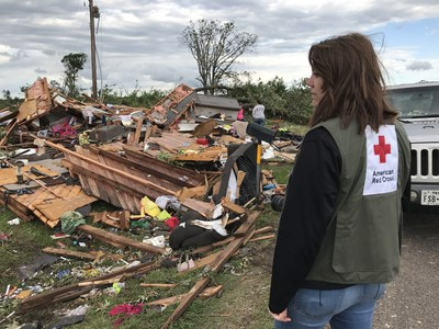 American Red Cross volunteer Bailey Moir surveys the damage in her hometown of Canton, TX after tornadoes swept through this past weekend. Source: PRNewsfoto/American Red Cross.