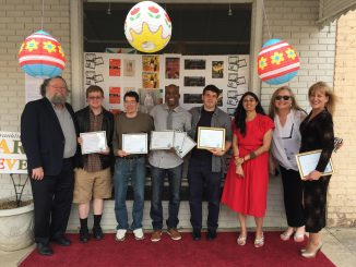 Award winners: Rebecca Bradely, [far right] USA rep for producer Pierre Gaffie JD Mayo, [3rd from left] Rodney T. Moore [4th from left], Gauri Singh [ 6th from left] Pamela Andrejev, FCAC coordinator [7th from left] and the cast and crew of movie Our War and holding their awards.